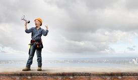 Constructor de la mujer con el megáfono Foto de archivo libre de regalías