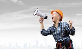 Constructor de la mujer con el megáfono Fotografía de archivo