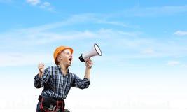 Constructor de la mujer con el megáfono Fotos de archivo libres de regalías