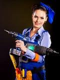 Constructor de la mujer con las herramientas de la construcción. Imagenes de archivo