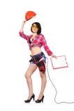Constructor de la mujer que sostiene el casco y el tablero Foto de archivo
