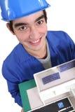 Constructor de pie con la casa modelo libre illustration