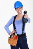 Constructor de sexo femenino con el taladro Fotos de archivo libres de regalías