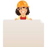 Constructor de sexo femenino Looking en el cartel en blanco en el top Foto de archivo libre de regalías