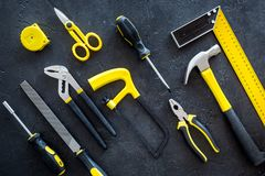 Constructor desk pattern with set of building implements dark desk background top view Stock Images