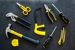 Constructor desk pattern with set of building implements dark desk background top view Stock Image