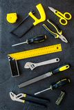Constructor desk pattern with set of building implements dark desk background top view Stock Photo