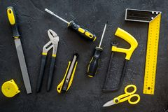 Constructor desk pattern with set of building implements dark desk background top view Stock Photos