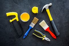 Constructor desk with set of building implements and brushes dark desk background top view Stock Photography