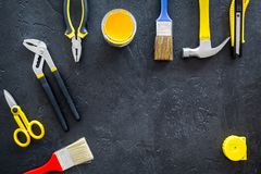 Constructor desk with set of building implements and brushes dark desk background top view mock up Royalty Free Stock Images