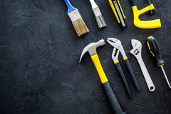 Constructor desk with set of building implements and brushes dark desk background top view mock up Stock Images