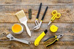 Constructor desk with set of building implements and brushes wooden desk background top view Royalty Free Stock Photography