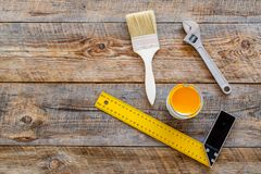 Constructor desk with set of building implements and brushes wooden desk background top view mock up Stock Photo