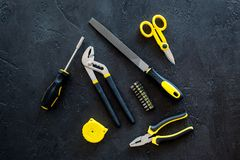 Constructor desk with set of building implements dark desk background top view Royalty Free Stock Photo
