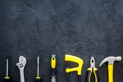 Constructor desk with set of building implements dark desk background top view mock up Stock Photos