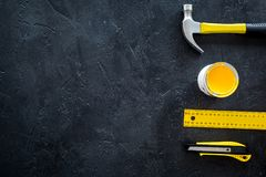 Constructor desk with set of building implements and paint dark desk background top view mock up Stock Photo