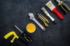Constructor desk with set of building implements and paint dark desk background top view mock up Royalty Free Stock Image