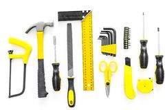 Constructor desk with set of building implements with screwdriver white desk background top view Stock Photos