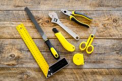 Constructor desk with set of building implements wooden desk background top view Royalty Free Stock Images