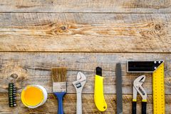 Constructor desk with set of building implements wooden desk background top view mock up Stock Images