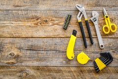 Constructor desk with set of building implements wooden desk background top view mock up Royalty Free Stock Image