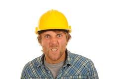 Constructor enojado en sombrero duro imagen de archivo libre de regalías