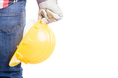 Constructor hand holding yellow helmet Royalty Free Stock Photos