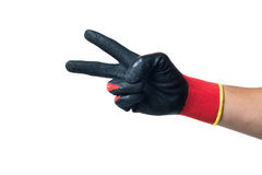Constructor hand in red rubber gloves showing Stock Image