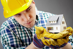 Constructor with house model royalty free stock photography