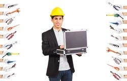 Constructor joven en el casco de la construcción Foto de archivo libre de regalías