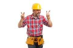 Constructor making quotation marks gesture in air royalty free stock images