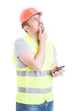 Constructor male looking worriend and thinking at something Stock Photography