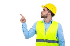 Constructor o constructor enojado que grita en alguien como concepto de la furia aislada en el fondo blanco con el copyspace fotografía de archivo