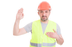 Constructor in protection clothes making swearing gesture Royalty Free Stock Photography