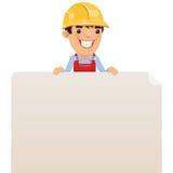 Constructor que mira el cartel en blanco en el top Imagen de archivo