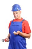 Constructor reading SMS disappointed Stock Photography