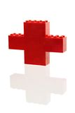 Constructor red plus. On the white background with reflection Royalty Free Stock Photography