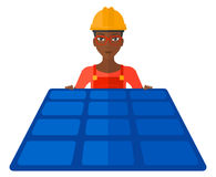 Constructor with solar panel Stock Photography