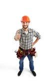 Constructor sonriente en casco y correa fotografía de archivo