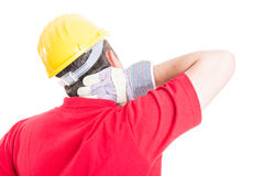 Constructor suffering back neck pain. Constructor, builder or contractor suffering back neck pain after work, stress or accident Stock Photo