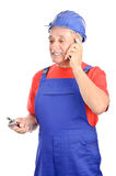 Constructor talking at cell phone Stock Photos