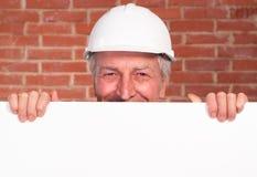 Constructor viejo en el casco Imagenes de archivo