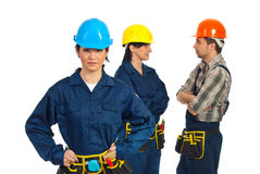 Constructor worker woman and her team Royalty Free Stock Photo