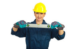 Constructor worker woman holding level Stock Photo