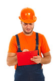Constructor worker writing. In a clipboard isolated on white background Stock Photo