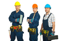 Constructor workers team. Constructor workers men team standing in a row isolated on white background Royalty Free Stock Images