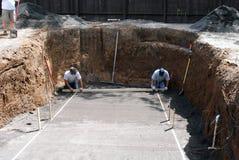 Constructores de la piscina Imagenes de archivo