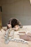 Constructores en el trabajo Imagenes de archivo