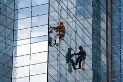 Constructors. Two constructors. High-rise building construction Royalty Free Stock Photo