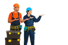 Constructors making presentation Royalty Free Stock Images